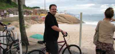 Darren cycling down Copacabana Beach